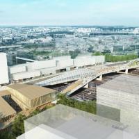 Perspective vue vers le Nord-Est, avec la future gare Saint-Denis Pleyel au premier plan. Source : AVP Mimram